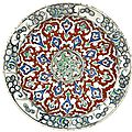 An iznik polychrome pottery dish with red ground, turkey, circa 1585