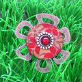 Une bague fleur métal bois
