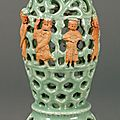 A biscuit-decorated longquan celadon taper holder, ming dynasty (1368-1644)