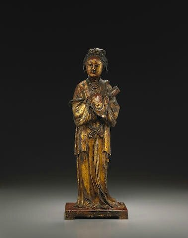 A polychrome and gilt lacquered bronze female attendant figure, Late Ming dynasty
