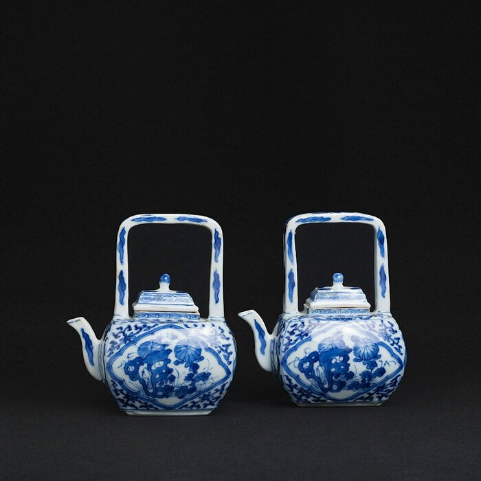 Pair of miniature arch handle Teapots, China, Kangxi period