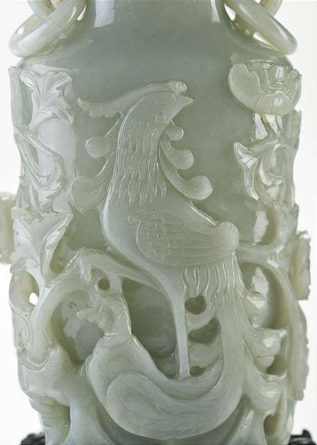 A fine openwork and relief carved jade vase with cover