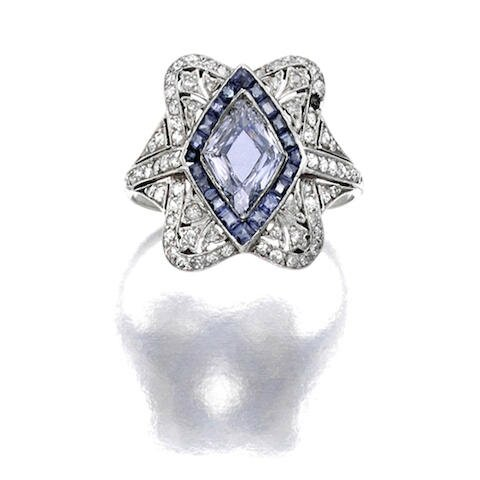 A fancy colored diamond, diamond and sapphire ring