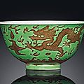 A green and aubergine enamelled 'dragon' bowl, kangxi six-character mark in underglaze blue within a double circle and of the pe