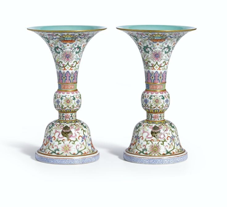 A pair of brilliantly enamelled famille-rose 'Bajixiang' vases, gu, seal marks and period of Qianlong