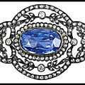 Antique russian brooch in silver and gold with an 11.25 carats central sapphire within a design of old-mine & rose-cut diamonds