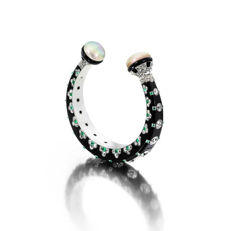 siegelson-art-deco-diamond-natural-pearl-emerald-and-onyx-bangle-by-cartier-circa-1925