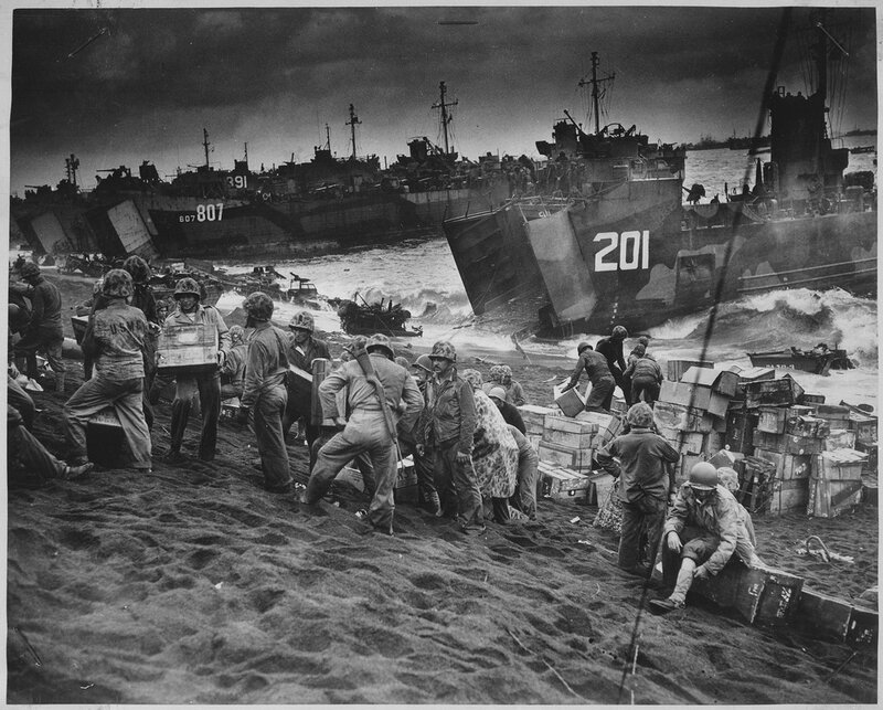 Out_of_the_gaping_mouths_of_Coast_Guard_and_Navy_Landing_Craft,_rose_the_great_flow_of_invasion_supplies_to_the____-_NARA_-_513218_tif