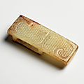 A white and russet jade patterned scabbard slide, warring states period (475-221 bc)