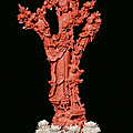 A red coral group with four Guanyin with blooming branches, China, Qing Dynasty, 19th century