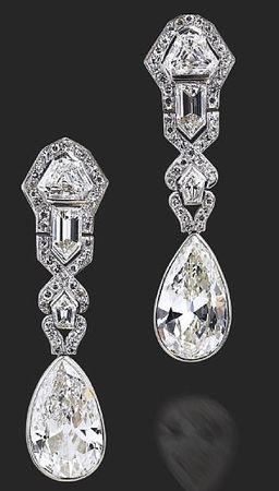 A_pair_of_Art_Deco_diamond_earrings__circa_1920