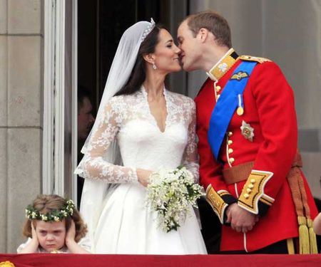 britain_s_prince_william_kisses_his_wife_kate_duchess_of_cambridge_on_the_balcony_of_buckingham_palace_pic_ap_702483650