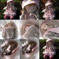 échange n°7: pour Karen, pour sa fille, une poupée de chiffon dans son couffin