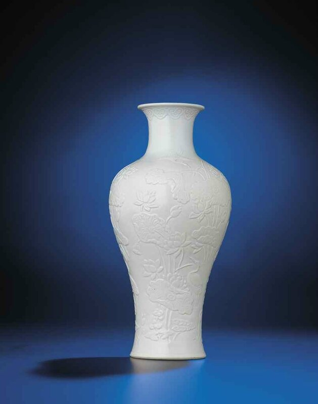 A rare relief-decorated white-glazed baluster vase, Qianlong incised six-character seal mark and of the period (1736-1795)