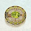 Gold, peridot and plique-à-jour enamel brooch, tiffany & co., designed by louis comfort tiffany, circa 1910