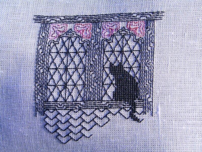 chat 3 à la fenêtre