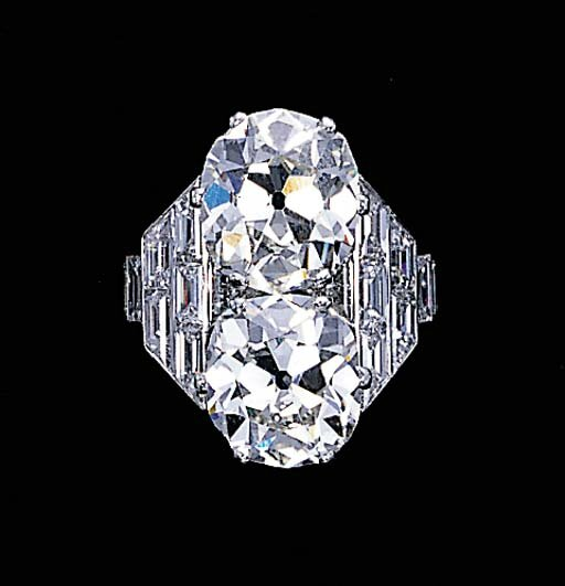 An impressive twin-stone diamond ring, by Cartier, circa 1935
