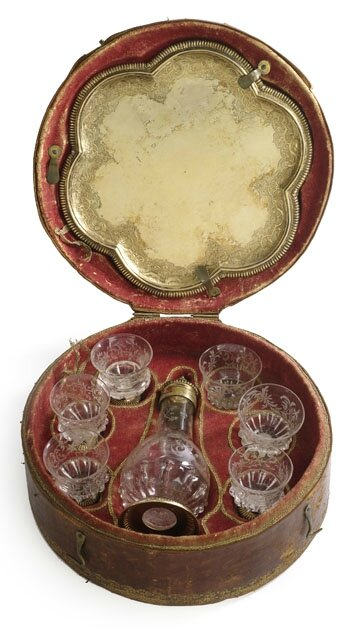 A rare Vermeil and glass liqueur service with the original embossed leather case by Elias Adam, Augsburg, 1712-15
