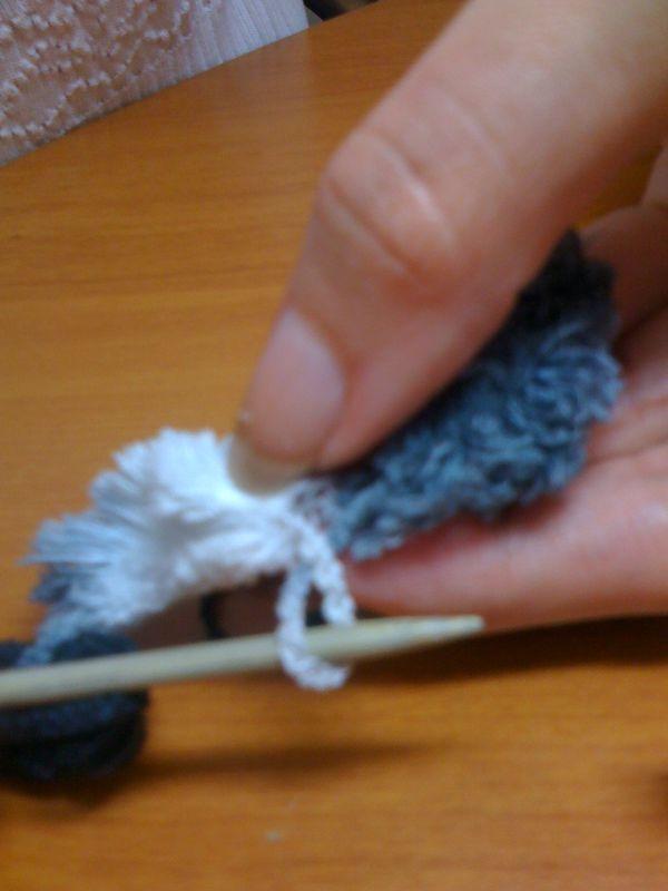 comment arreter une echarpe en laine pompon