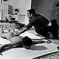 Yves klein in his studio, directing a model in body art painting (1961)