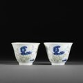 A pair of small famille verte 'month' cups, daoguang six-character marks and of the period