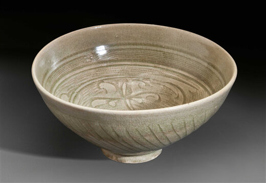A_celadon_carved_bowl__China__Yuan_Ming_Dynasty__13th_15th_century
