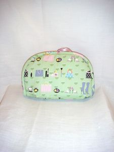 Trousse maquillage vert violette dos flash