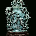 A turquoise capped vase finely sculpted with floral motives, China, Qing Dynasty, Qianlong Period (1736-1795)