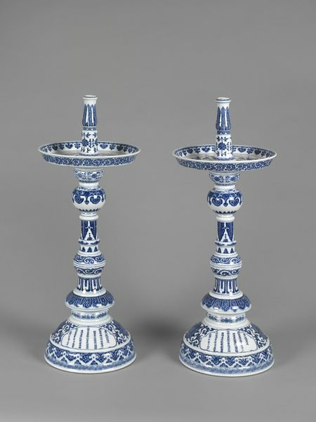 Pair of candlesticks with a inscription within a cartouche on the foot, China (Jingdezhen), Qing dynasty, Qianlong period, dated 1741