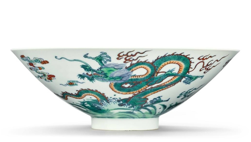 A fine and rare doucai conical 'Dragon' bowl, Yongzheng seal mark and period (1723-1735)