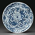 A large blue and white 'dragon' dish, wanli six-character mark in underglaze blue within a double-circle and of the period