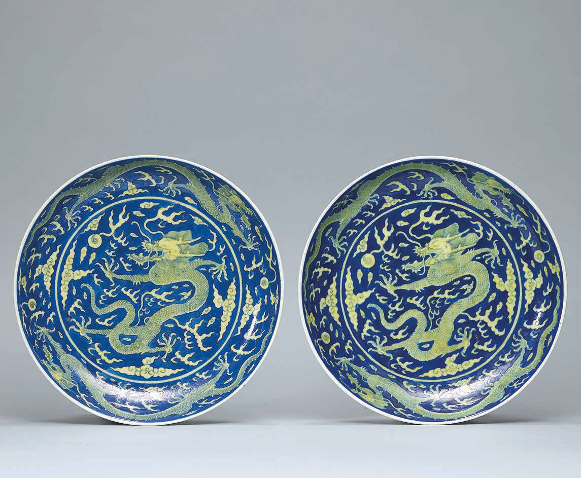 A pair of blue-ground yellow-enamelled 'Dragon' dishes, Daoguang six-character seal marks in underglaze blue and of the period