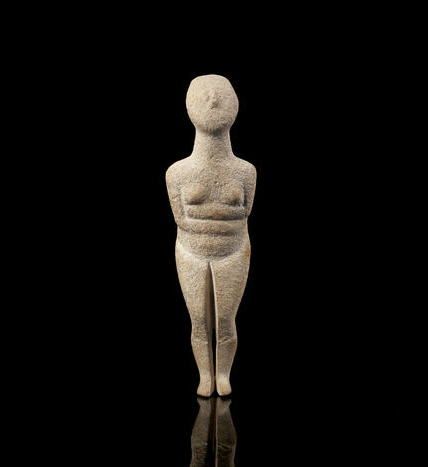 A Cycladic marble female idol, Early Spedos Type, Early Cycladic II, 2700-2500 B.C.