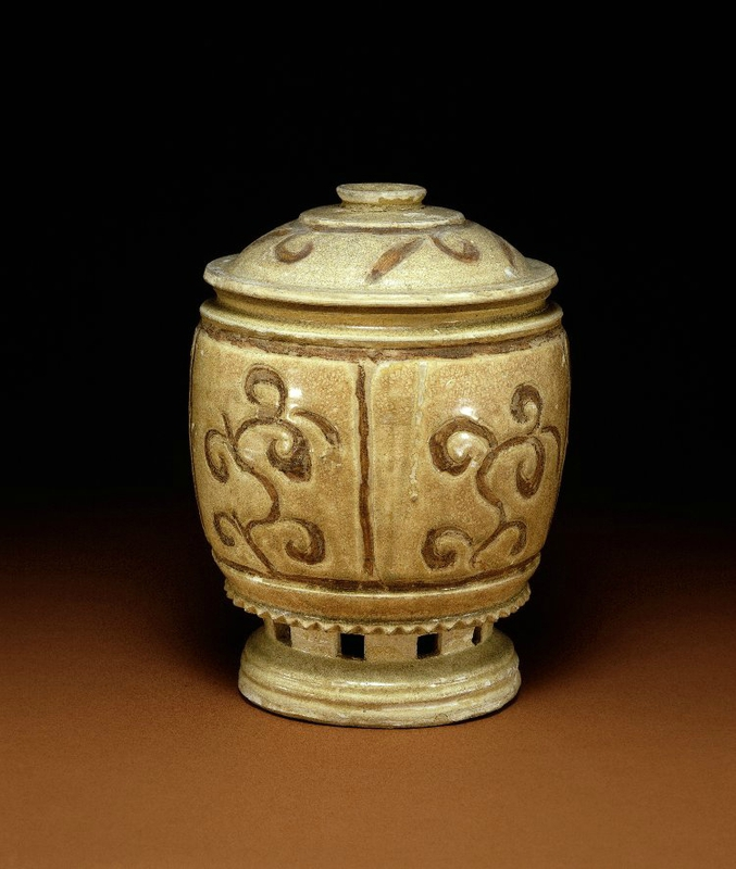 Lid urn, 10thC-11thC, Vietnam. Panels with flower motifs.With ring foot. Made of pierced and cream glazed stoneware. Purchased from John Sparks, Ltd. 1931,0320.1.b. British Museum © The Trustees of the British Museum.