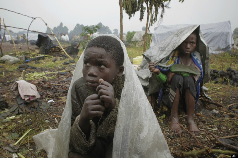 IDP-camp-children-in-rainstorm-Kibati-north-of-Goma-eastern-Congo-080812-by-Jerome-Delay-AP