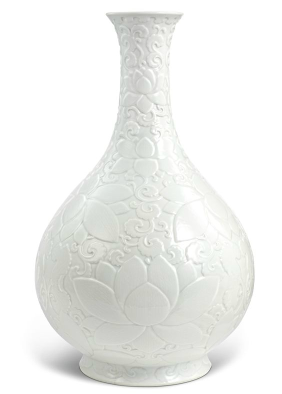 An important and rare relief-carved white-glazed 'lotus' vase, Qianlong seal mark and period (1736-1795)