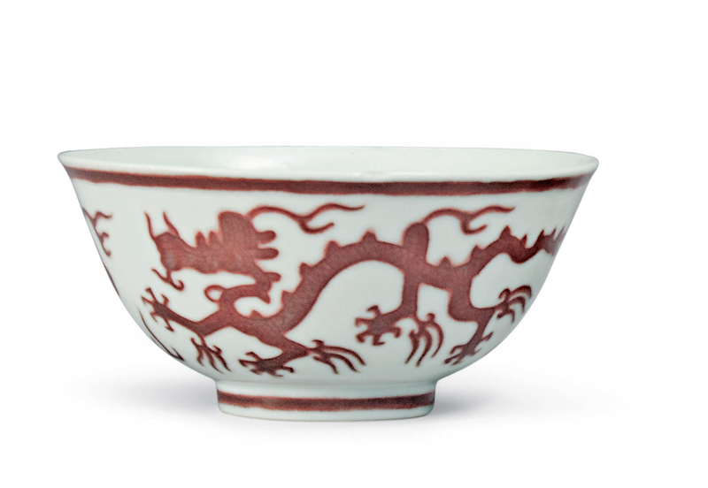 A pair of copper red-decorated 'dragon' bowls, Kangxi six-character marks in underglaze blue within a double circle and of the period (1662-1722) 1