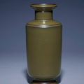 A fine and very rare teadust-glazed cylindrical vase, Yongzheng incised four-character seal mark and of the period (1723-1735)