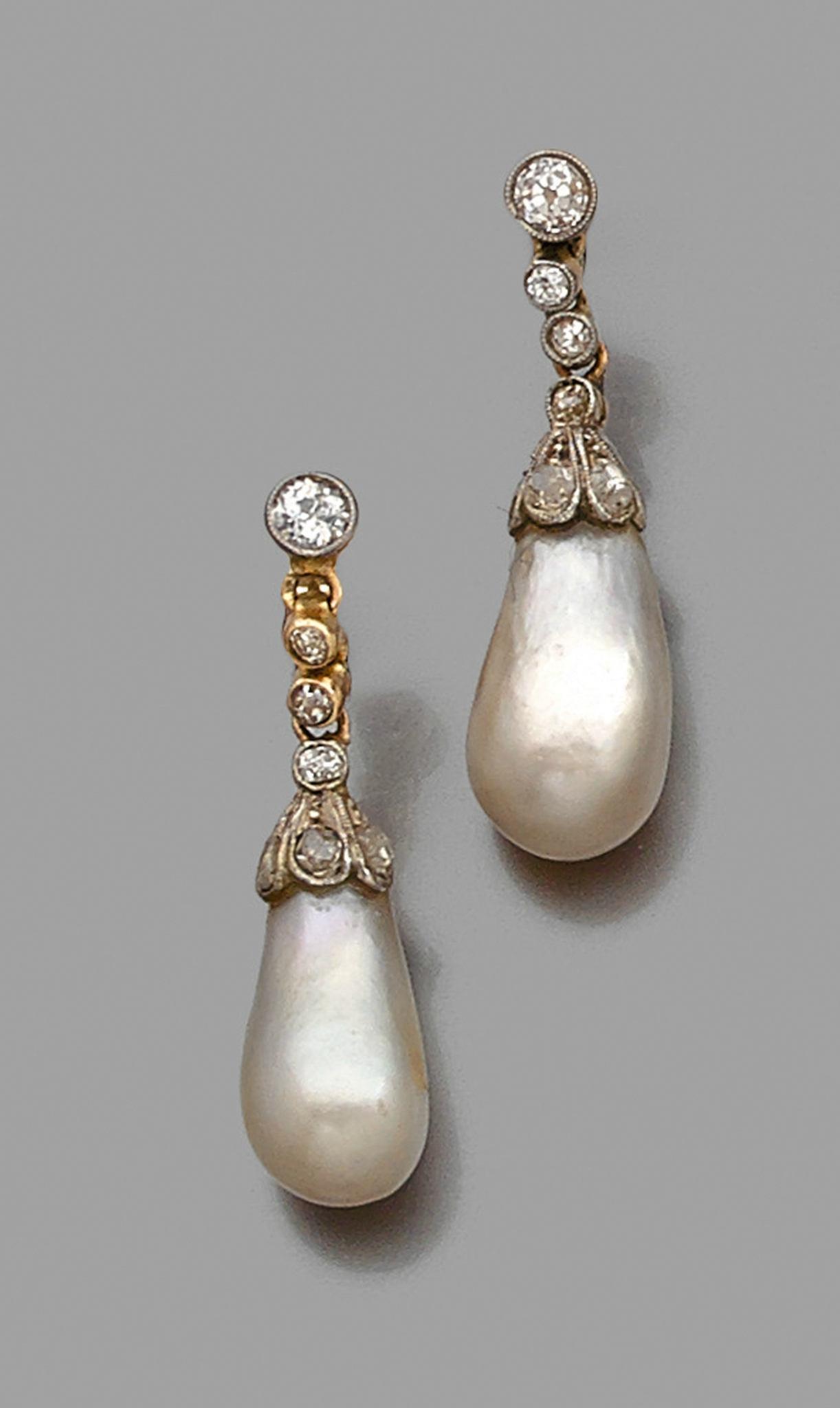 A natural pearl, diamond and gold ear pendant