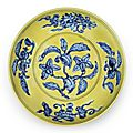 A rare underglaze-blue yellow-ground 'gardenia' saucer dish, Zhengde six-character mark and of the period (1506-1521)