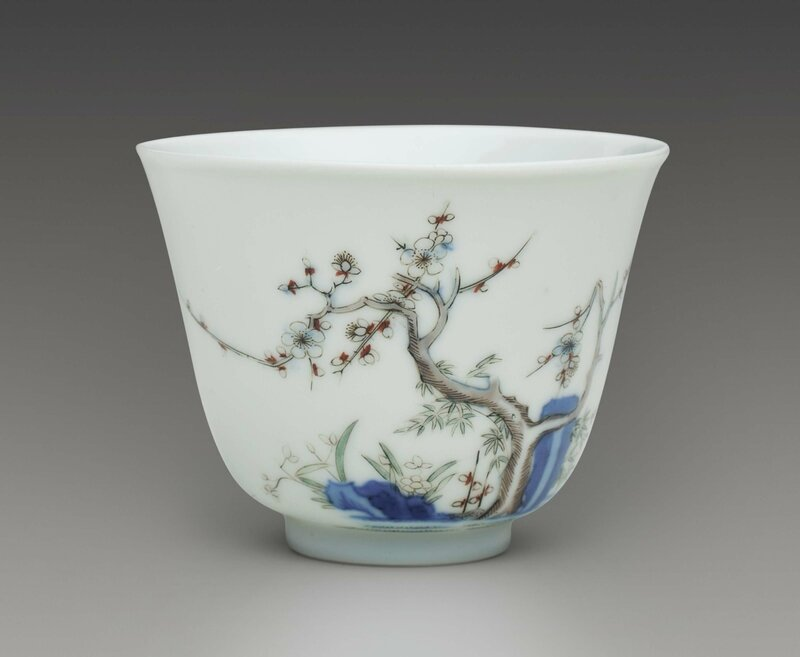 A famille verte 'Prunus' 'Month' cup, Kangxi six-character mark in underglaze-blue within a double circle and of the period (1662-1722)
