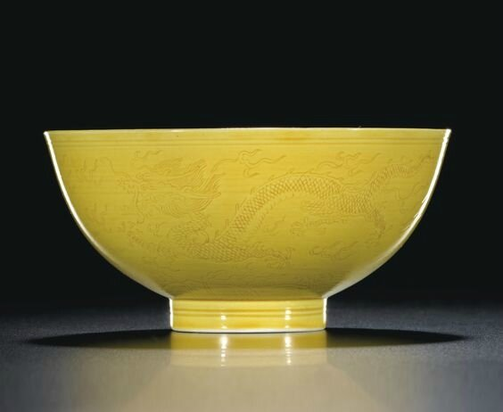 An incised yellow-glazed 'Dragon' bowl, mark and period of Xianfeng