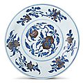 A large blue and white and underglaze-red 'peach' dish, seal mark and period of Qianlong (1736-1795)
