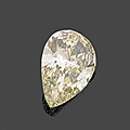 An unmounted champagne pear-shaped diamond weighing 8,30 cts. photo hôtel des ventes de monte-carlo beau diamant champagne sur