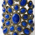 Andrew Gn, jewelled statement cuff cast in bronze with lapis blue glass cabochons in beaded oval settings