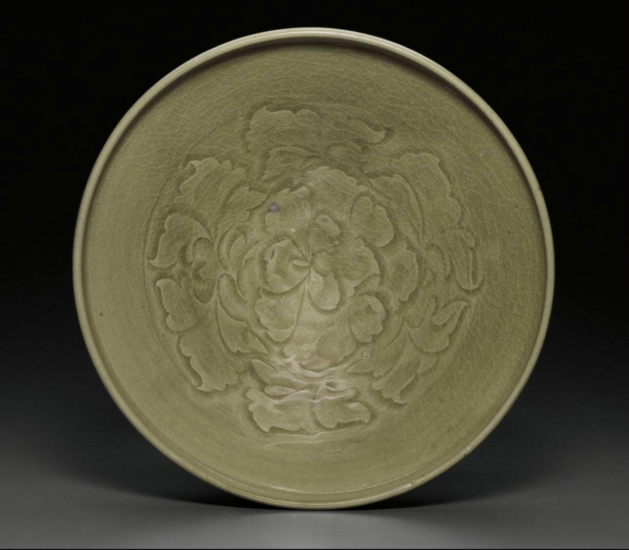 A large carved Yaozhou celadon bowl, Northern Song dynasty (AD 960-1127)