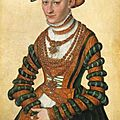 Lucas cranach ii (wittenberg 1515 - 1586), portrait of a lady; three quarter length, in a geen velvet and orange dress and pear-
