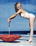 1949_tobey_beach_by_dedienes_umbrella_red_060_3