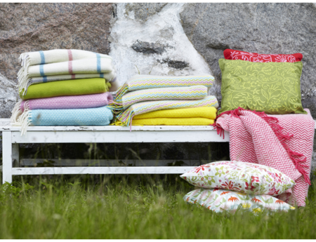 Bench-with-colourful-wool-throws-and-cushions