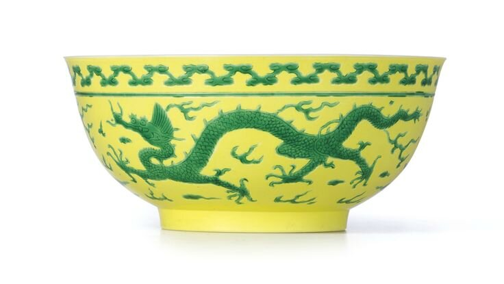 A fineyellow-ground green-enamelled 'Dragon' bowl, Mark and period of Yongzheng